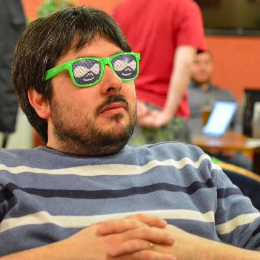 Pedro Cambra wearing sunglasses with the Drupal logo