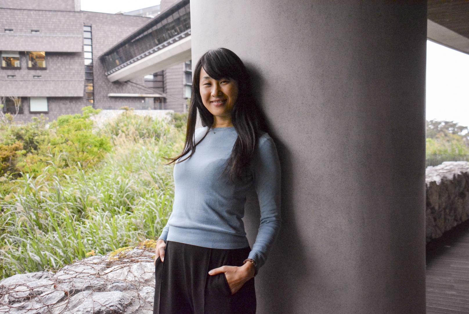 Tomomi Okubo outside smiling